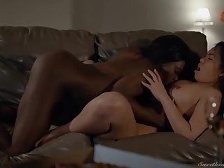 An Asian and an Ebony Girl Making Love