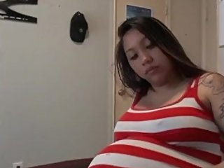 Hot Asian Preggo plays with massive belly