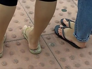 2 Japanese girls candid walking in flip flops