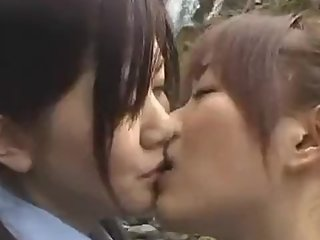 Asian schoolgirls have fun with each other