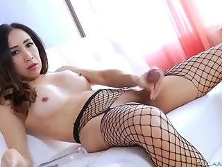 Gorgeous Asian Ladyboy Strokes Her Big Dick and Cums
