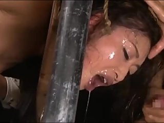 Lock Jap slave Reiko in cangue & face fuck her until oral creampie