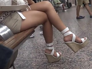 Crossed legs asian slut feet in towering platform sandals